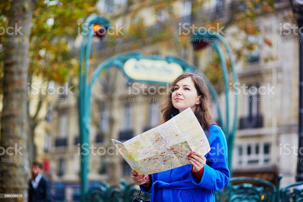 Beautiful young tourist in Paris, stock photo