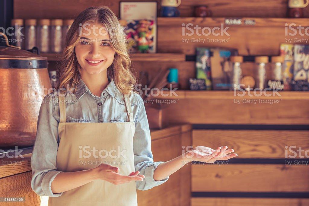 Beautiful young waitress stock photo