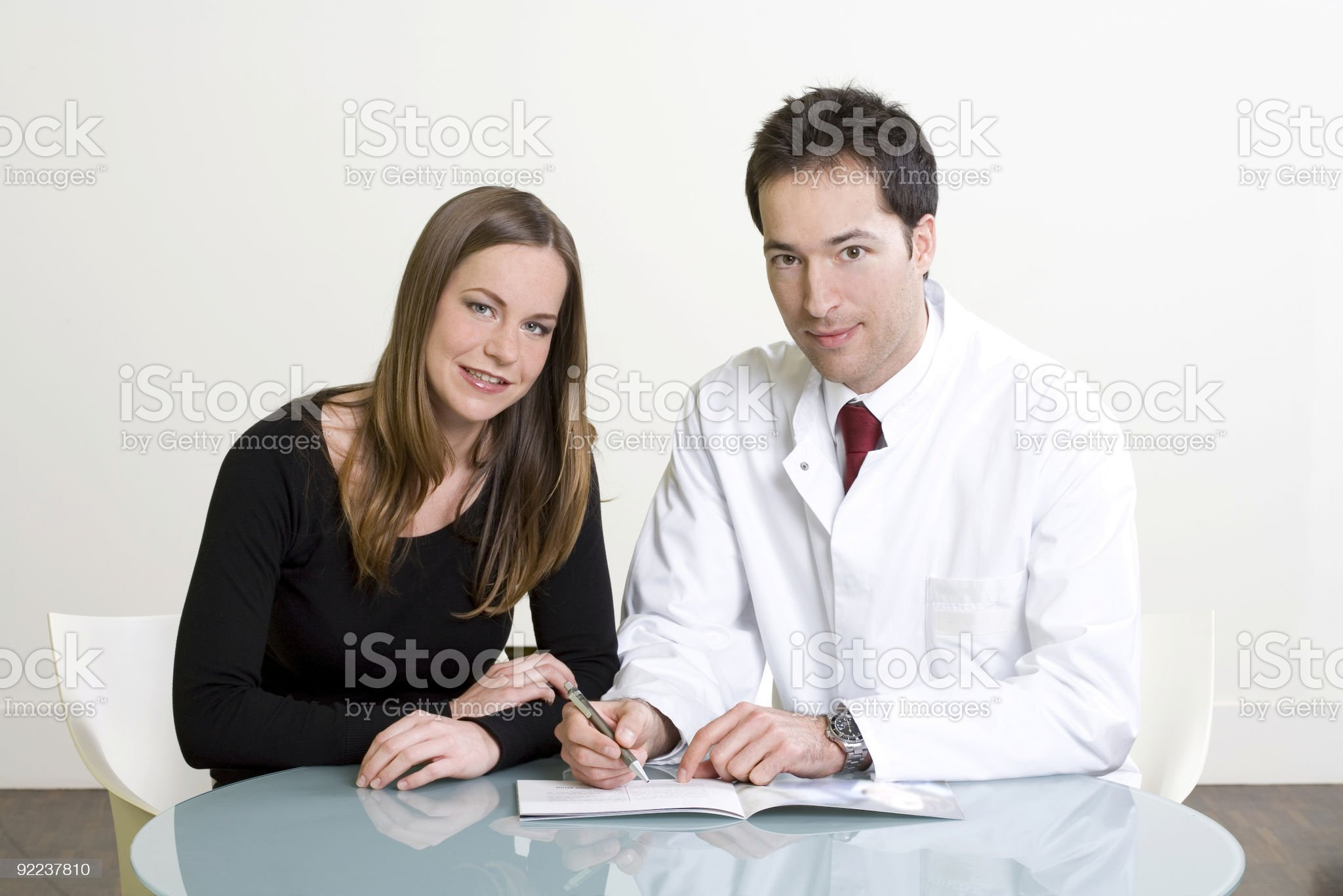 Beautiful young woman and doctor at consultation royalty-free stock photo