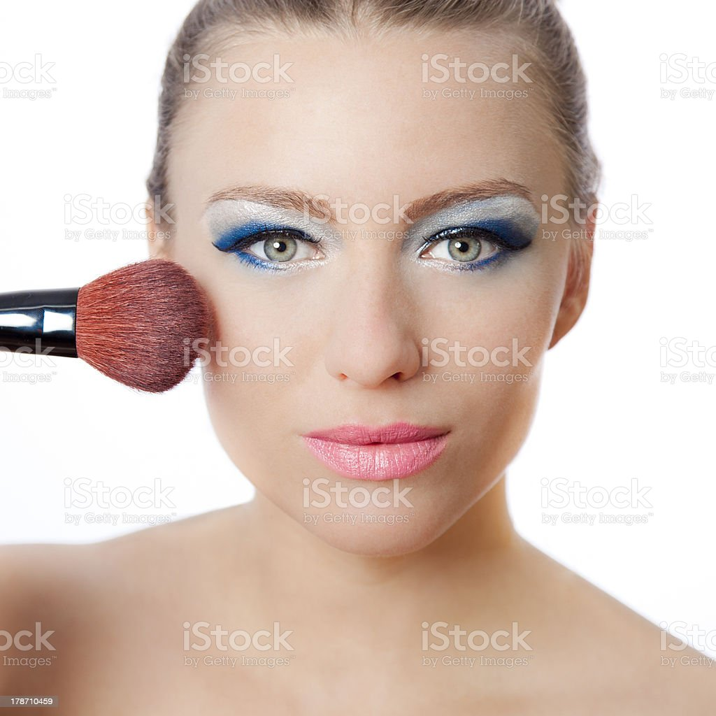 Beautiful young woman applying makeup royalty-free stock photo