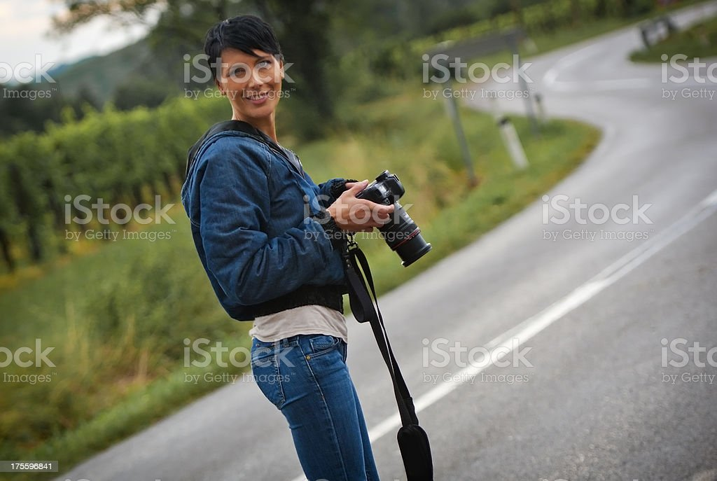 Beautiful young woman as photographer stock photo