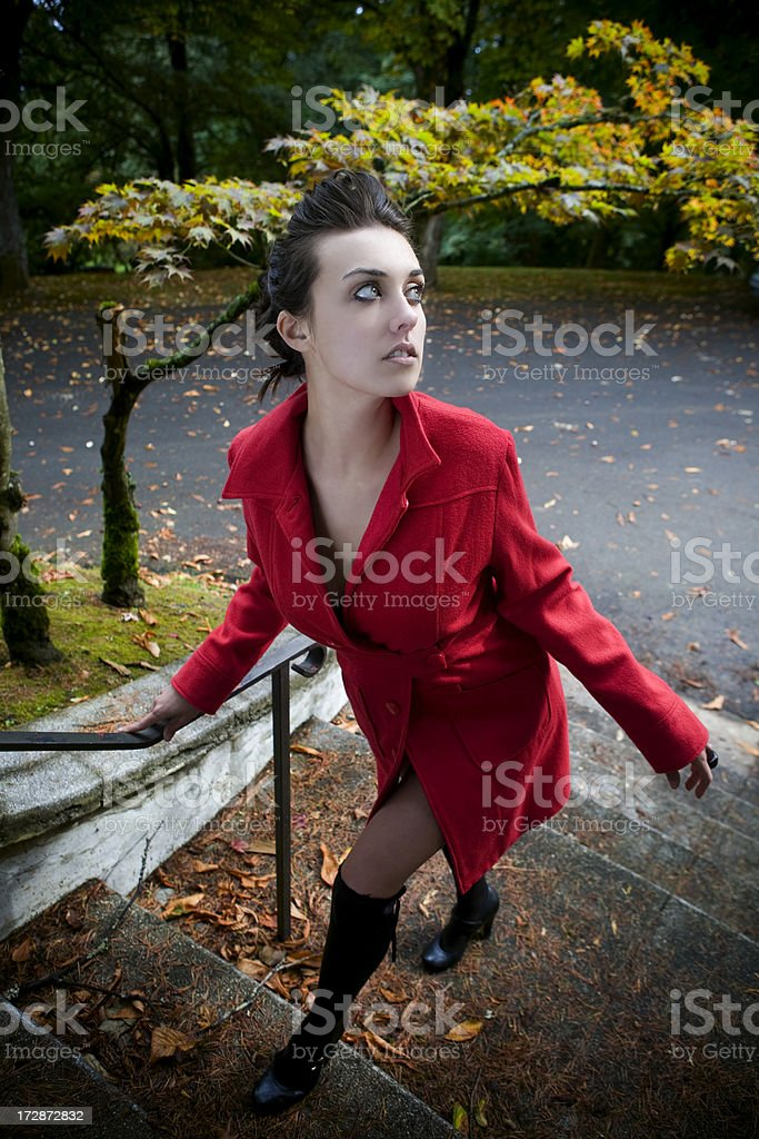 Beautiful Young Woman Ascending Stairs Outside on Fall Day stock photo