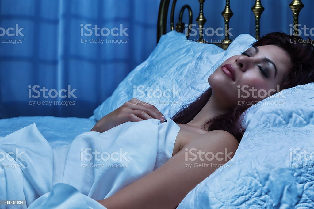 Beautiful Young Woman Asleep in Bed stock photo
