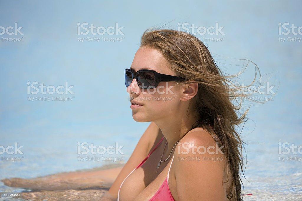 Beautiful young woman at a pool royalty-free stock photo