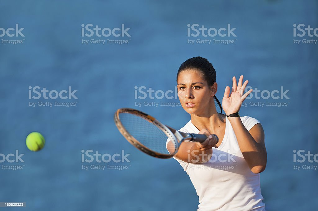 Beautiful young woman at forehand stock photo