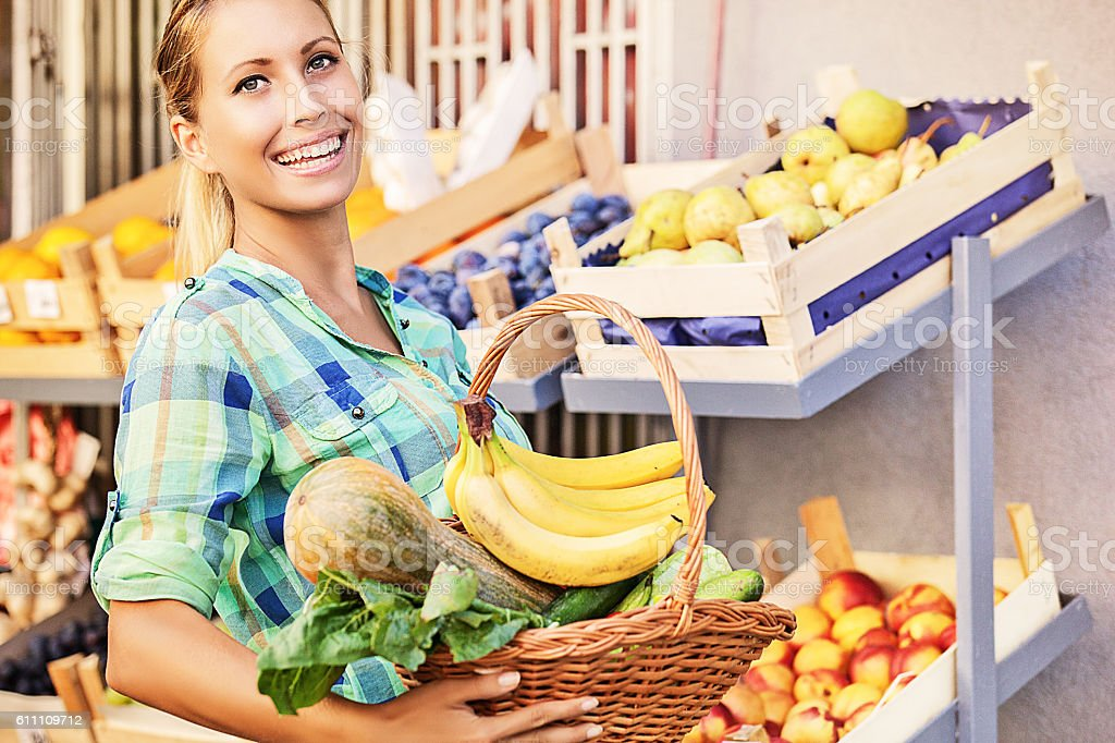 Beautiful young woman at grocery store. stock photo