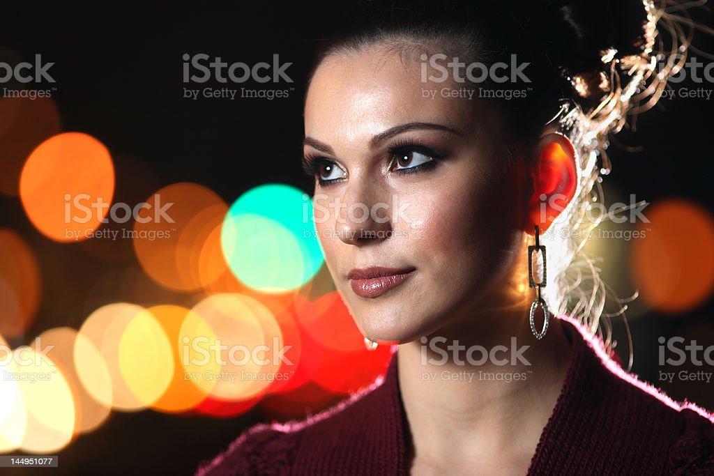 Beautiful young woman at night royalty-free stock photo