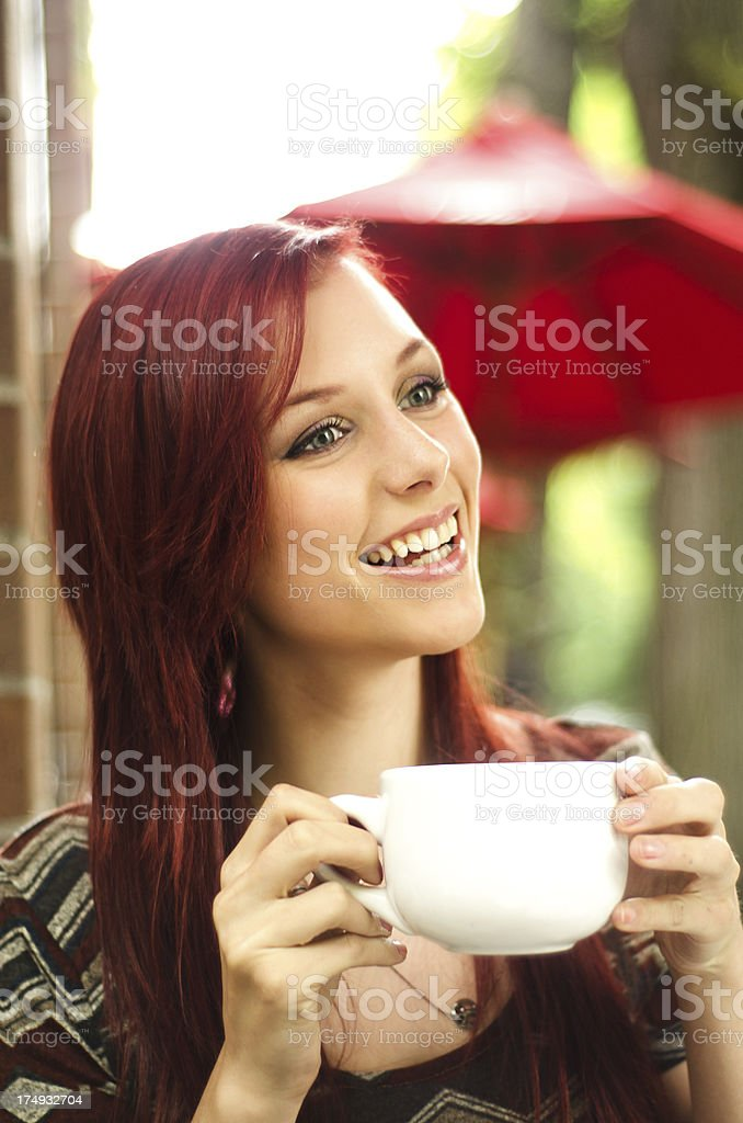 Beautiful young woman at sidewalk cafe royalty-free stock photo