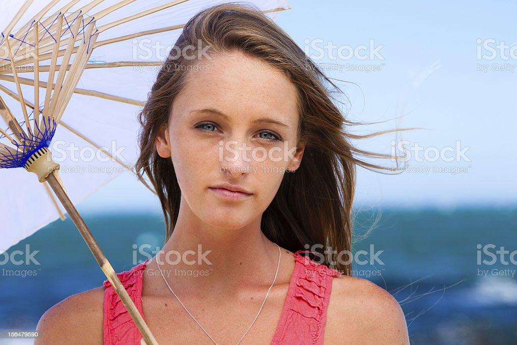 Beautiful young woman at the beach stock photo