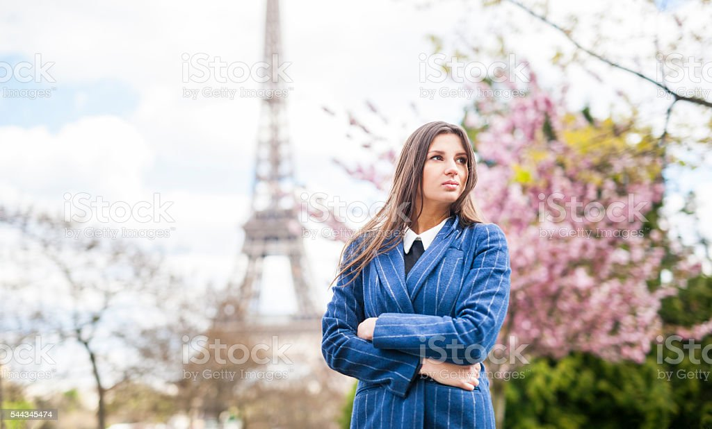 Beautiful Young Woman At The Eiffel Tower stock photo
