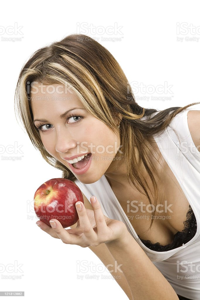 Beautiful young woman biting a red apple. stock photo