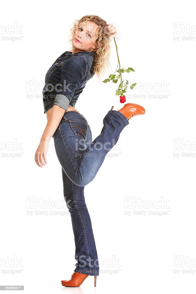 Beautiful young woman blonde in jeans romantic red rose isolated royalty-free stock photo
