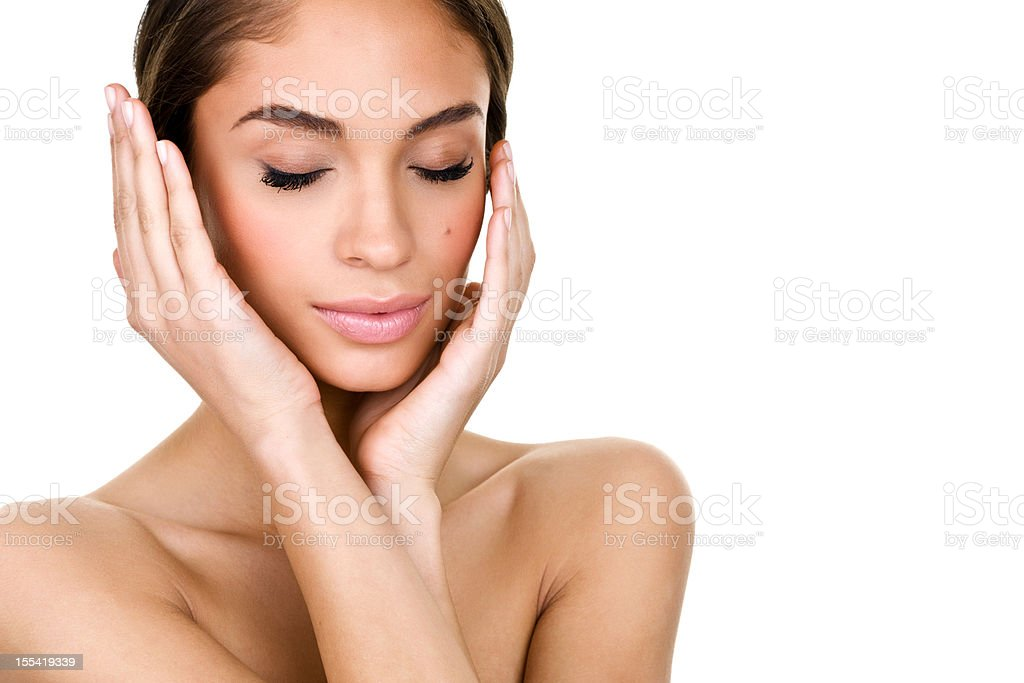 Beautiful young woman caressing her face royalty-free stock photo