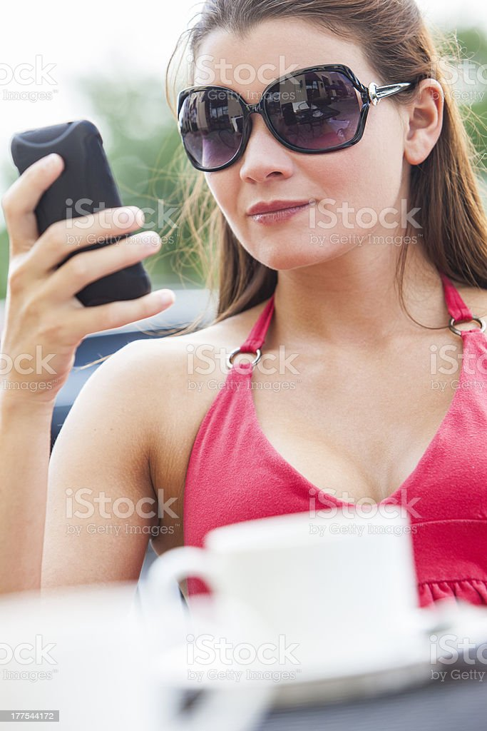 Beautiful Young Woman Cell Phone Texting in Cafe royalty-free stock photo