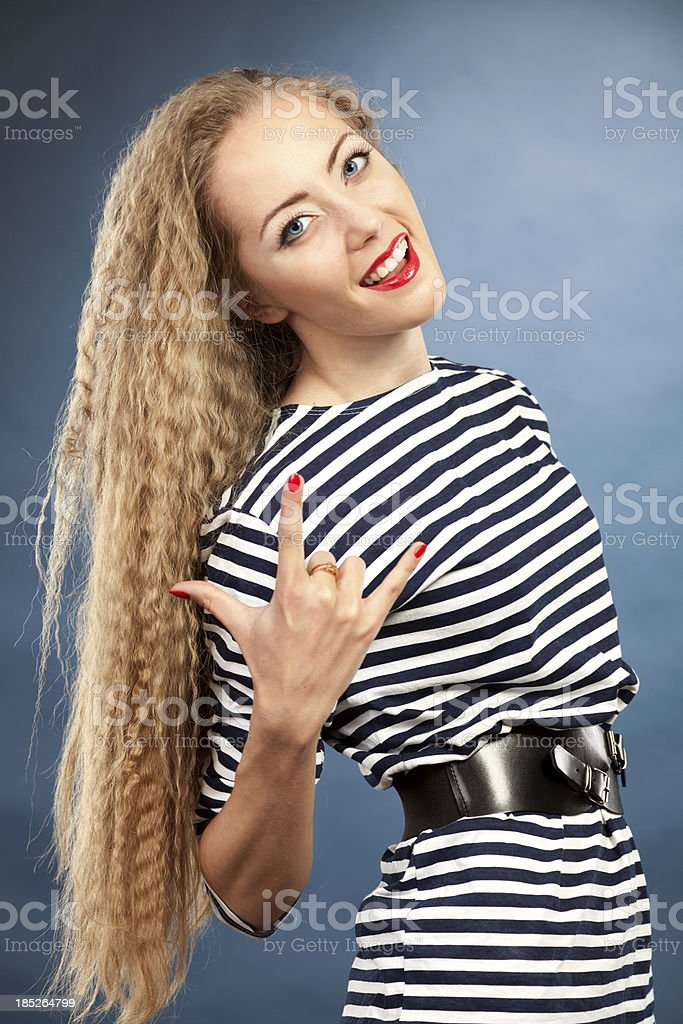 beautiful young woman cheerfully gesticulating stock photo