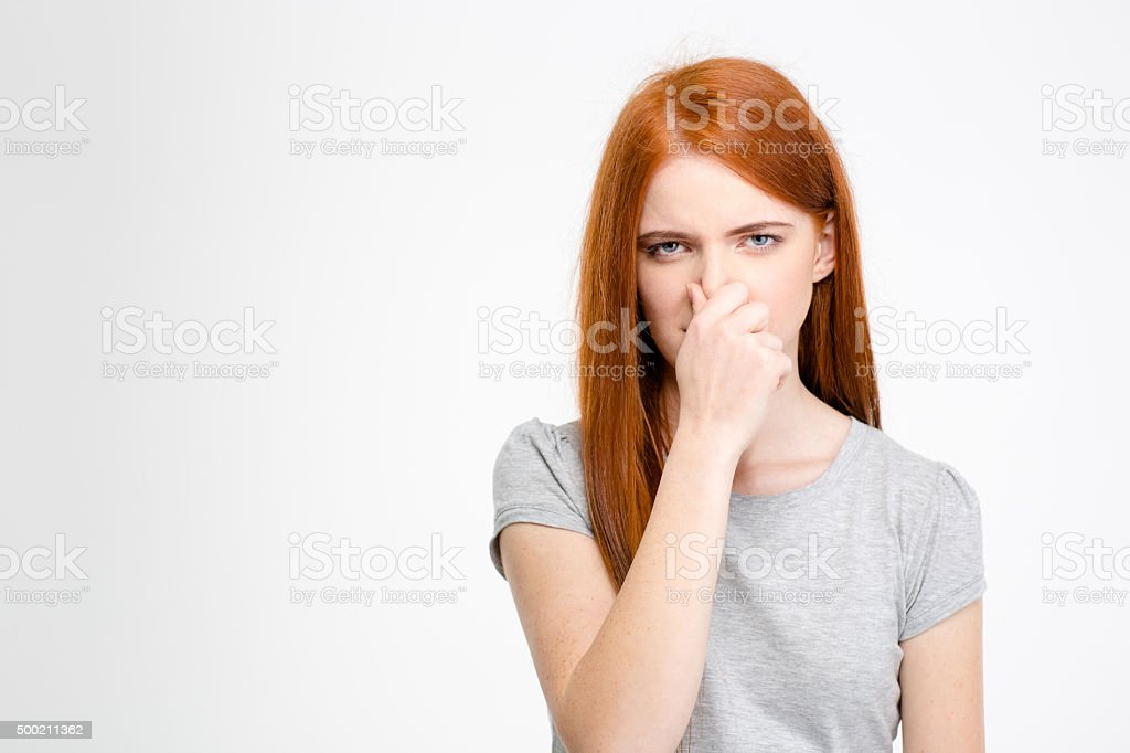 Beautiful young woman closed her nose by hand stock photo