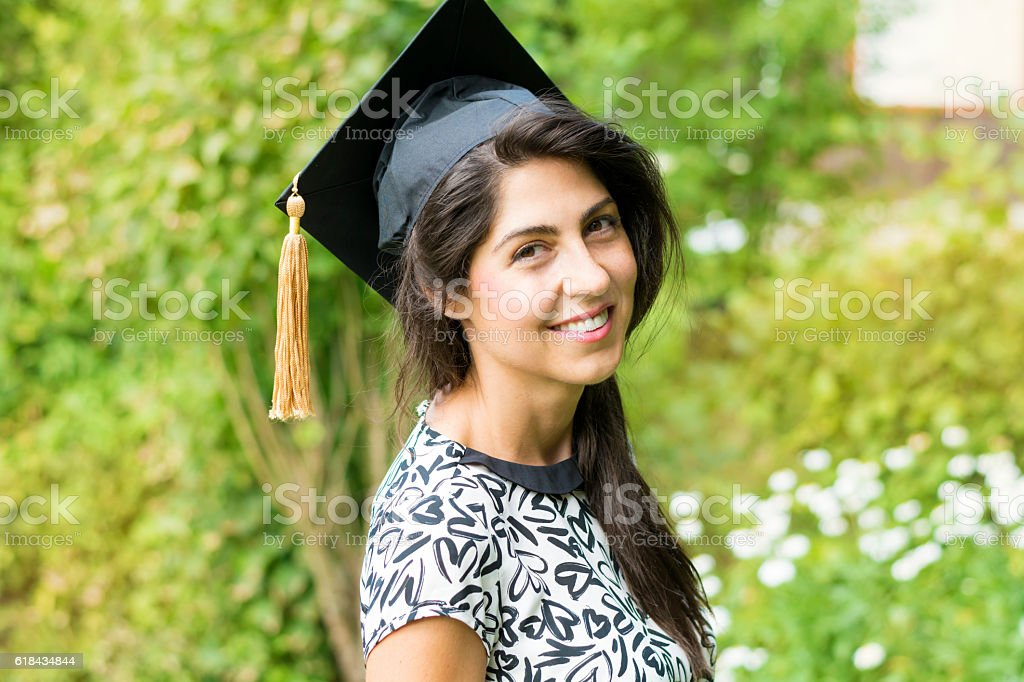 beautiful young woman college graduation stock photo