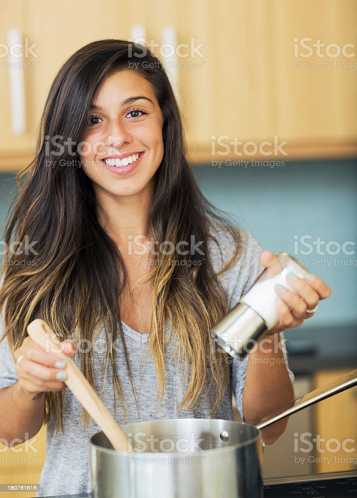 Beautiful Young Woman Cooking Dinner stock photo