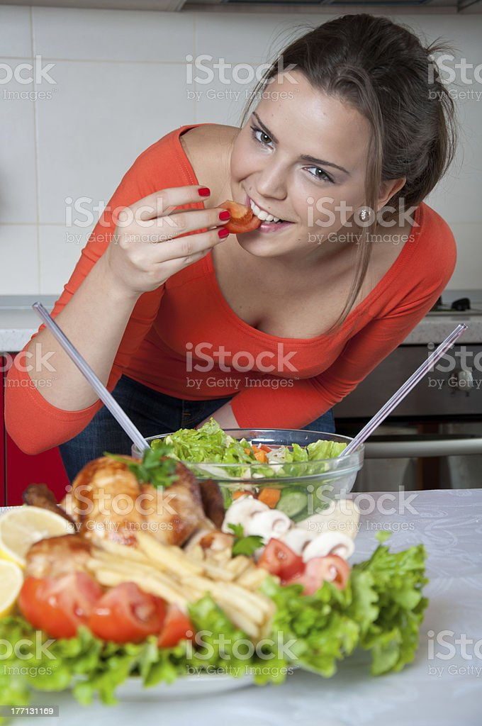 Beautiful young woman cooking royalty-free stock photo