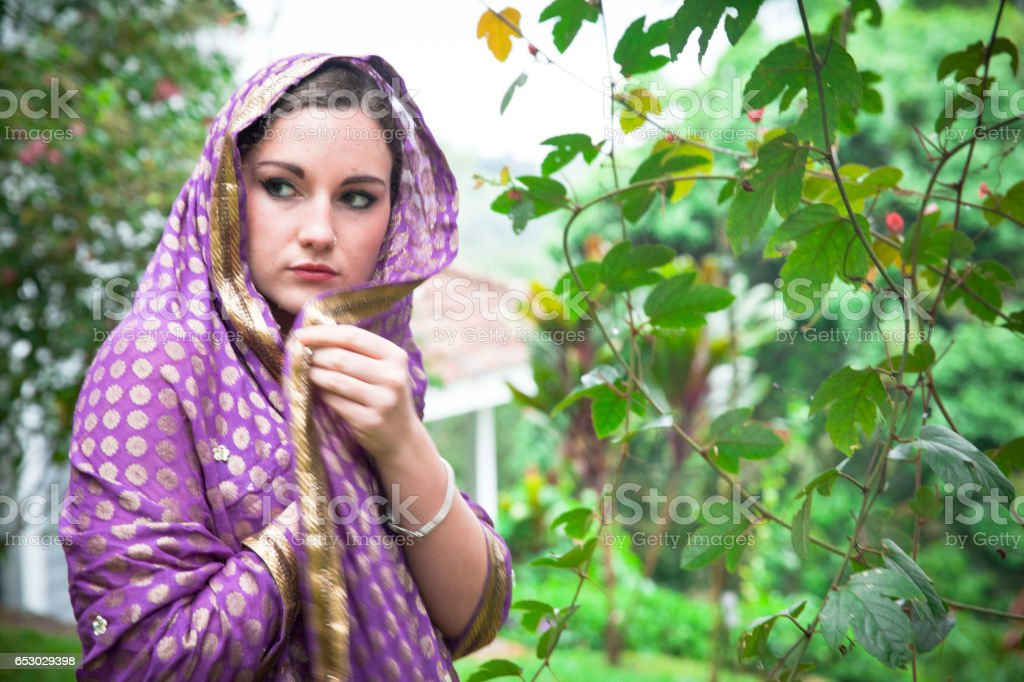 Beautiful Young Woman covering herself. stock photo