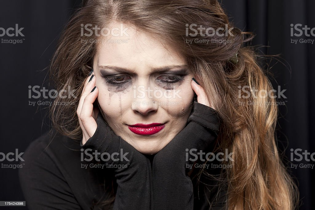Beautiful young woman crying stock photo