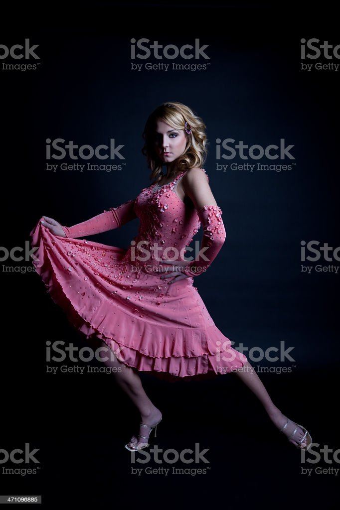 Beautiful Young Woman Dancer Posing in Dress on Black, Copyspace royalty-free stock photo