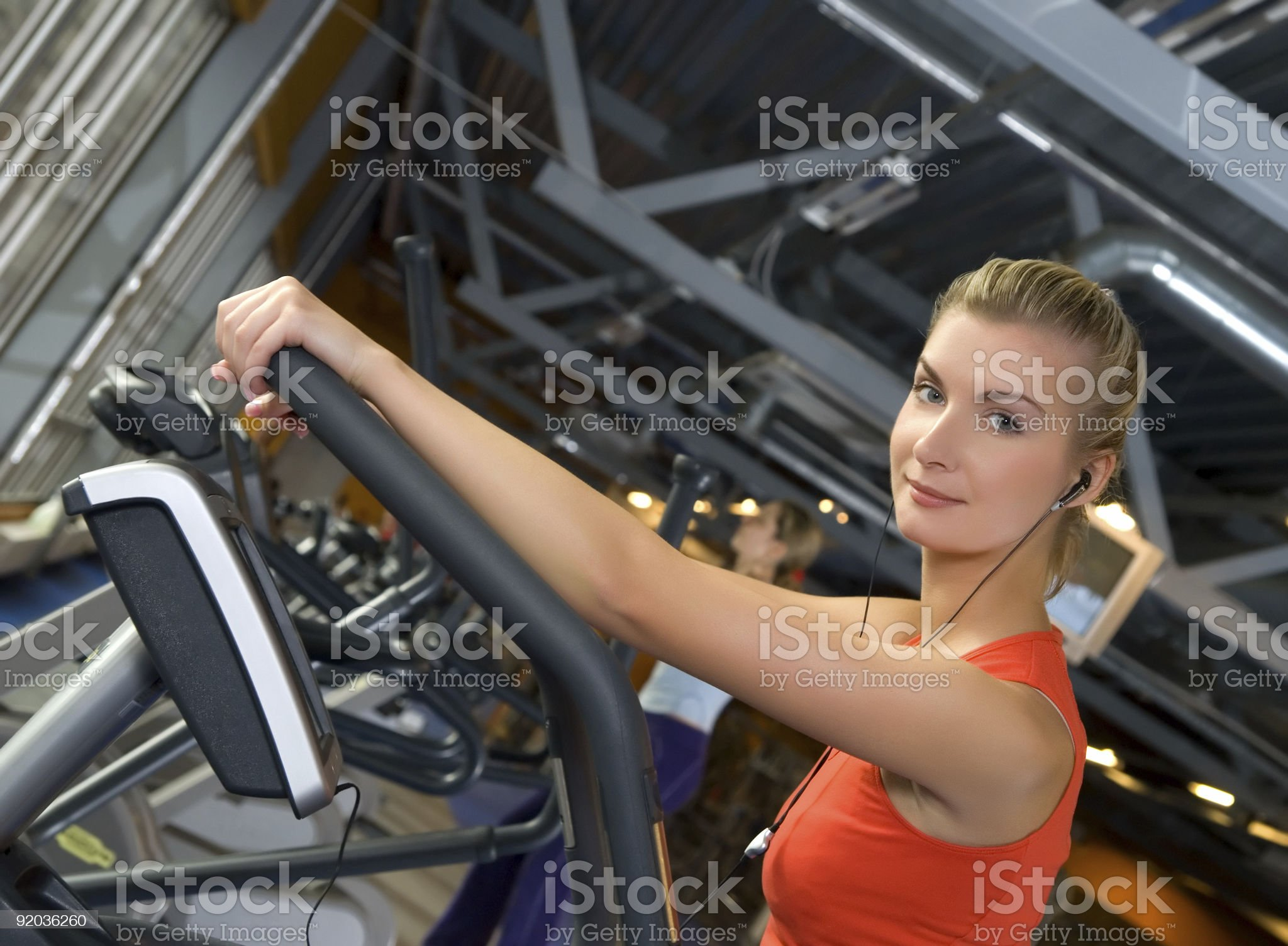 Beautiful young woman doing exercise in a gym royalty-free stock photo