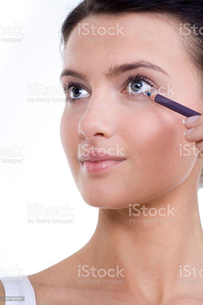 Beautiful Young Woman Doing Makeup royalty-free stock photo