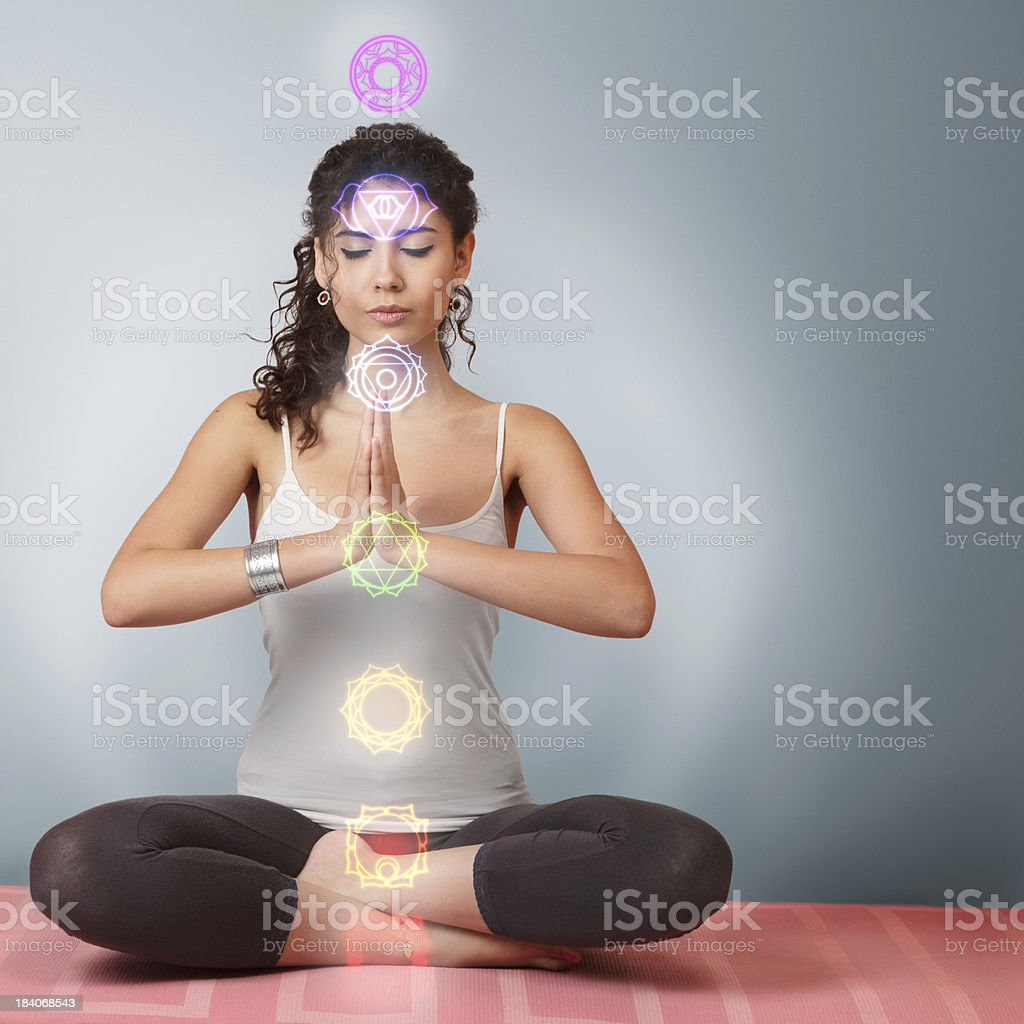 Beautiful young woman doing yoga exercise stock photo