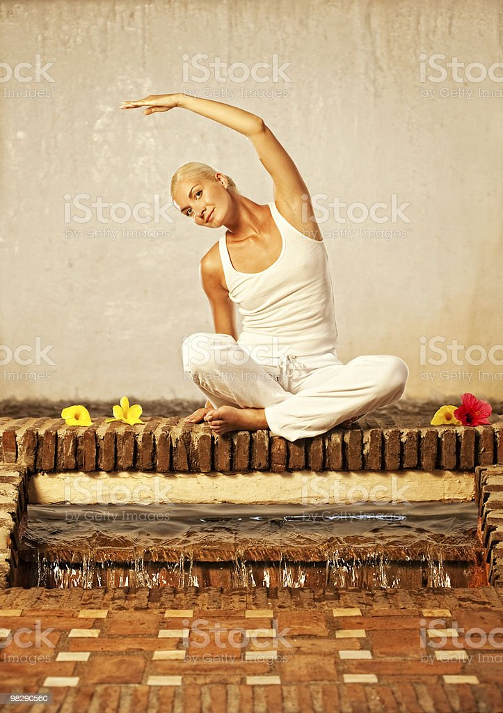 Beautiful young woman doing yoga exercise royalty-free stock photo