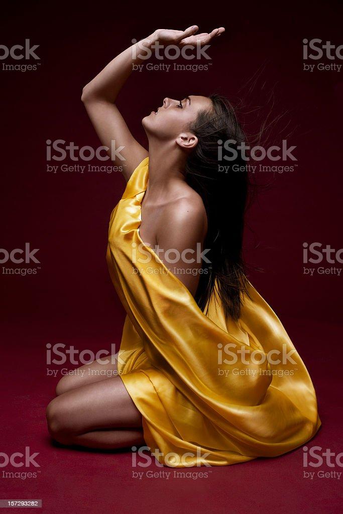 Beautiful Young Woman Draped in Yellow Silk, Copy Space stock photo