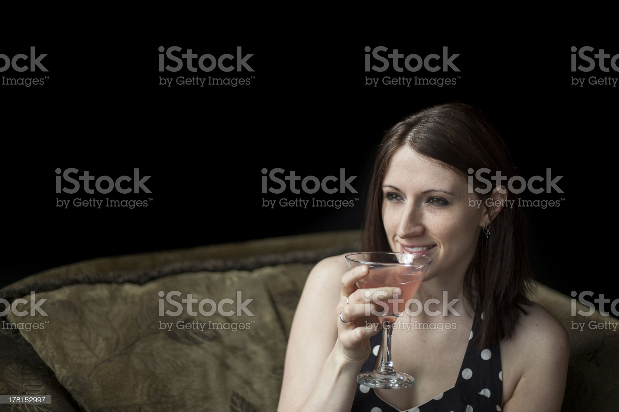 Beautiful Young Woman Drinking a Pink Martini royalty-free stock photo