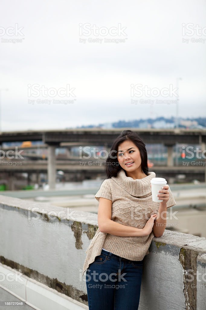 Beautiful young woman drinking coffee royalty-free stock photo