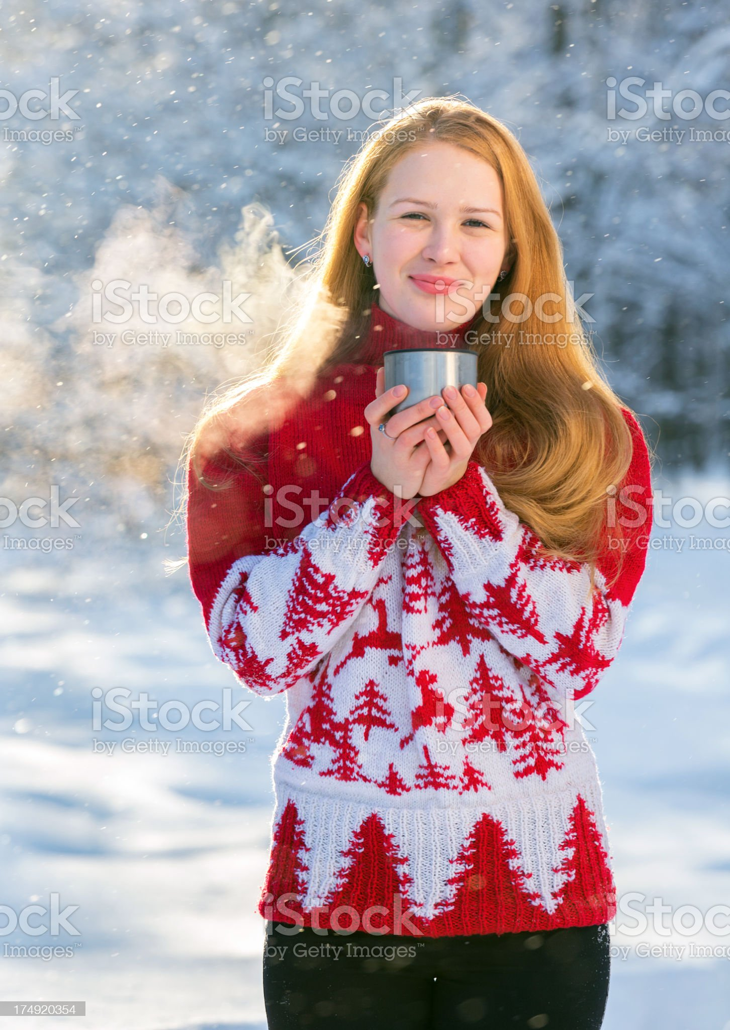 Beautiful young woman drinking tea in frost royalty-free stock photo