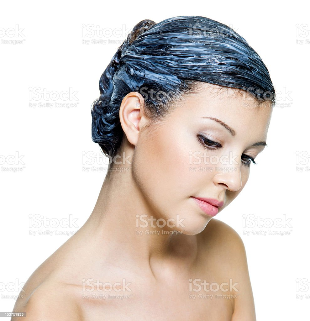 beautiful young woman dyeing hairs royalty-free stock photo