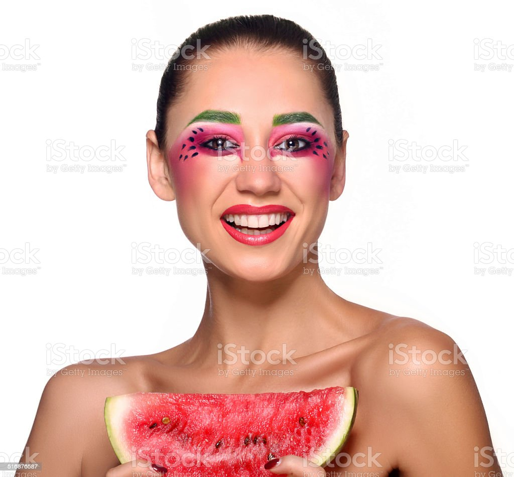 Beautiful young woman eating watermelon royalty-free stock photo