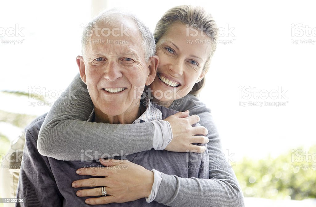 Beautiful young woman embracing her father stock photo