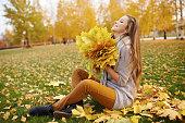 Beautiful young woman enjoying autumn