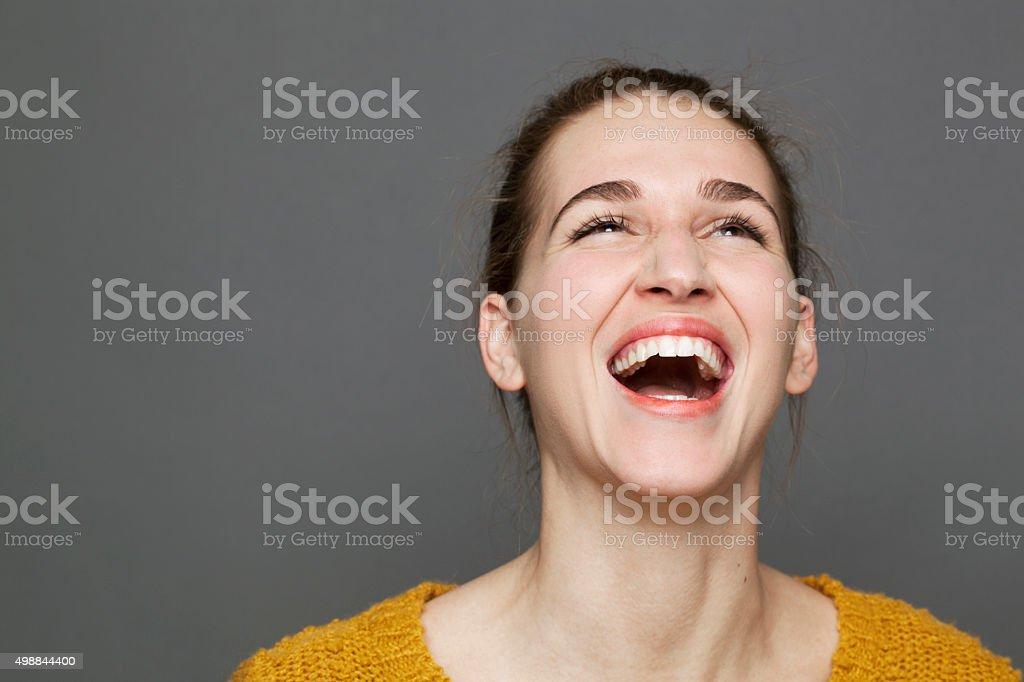 beautiful young woman enjoying laughing expressing natural happiness stock photo