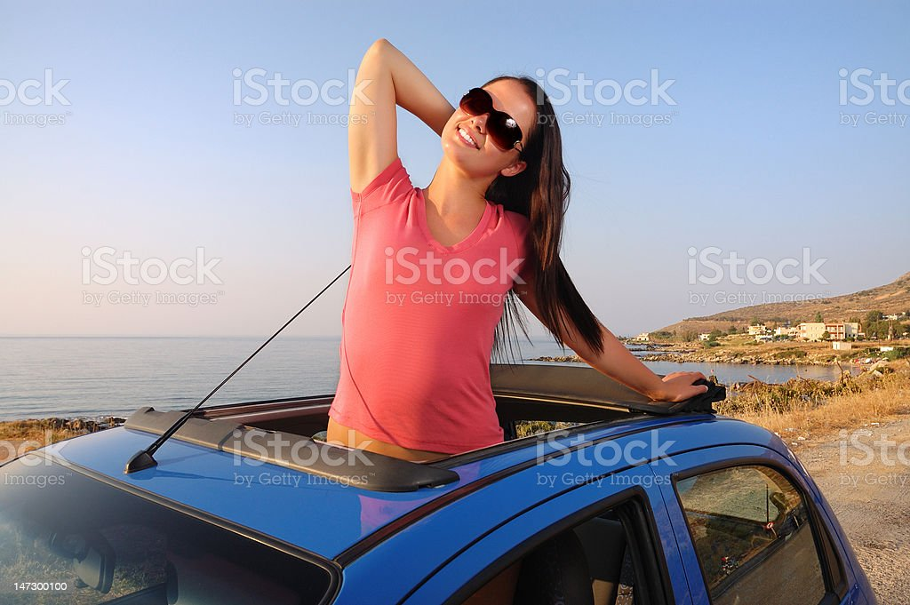Beautiful young woman enjoying  sunset at the seaside royalty-free stock photo