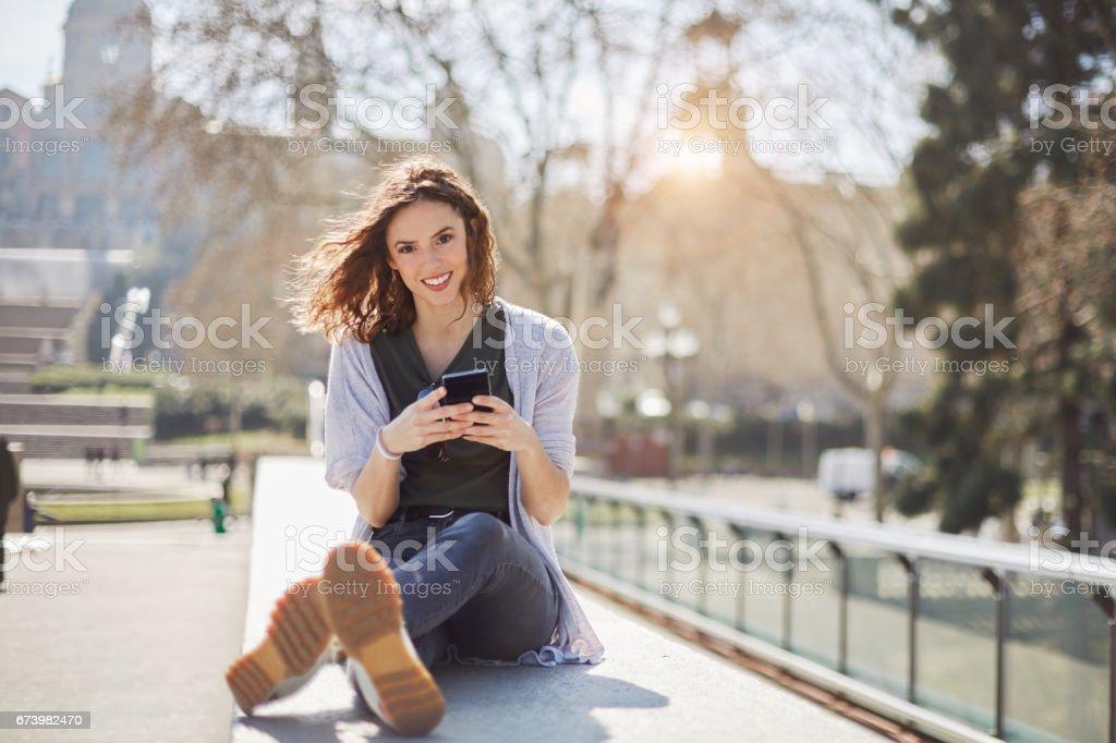 Beautiful young woman enjoying the city, Barcelona. stock photo