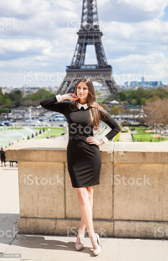 Beautiful Young Woman Enjoying Time At Eiffel Tower in Summertime stock photo