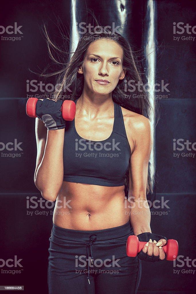 Beautiful young woman exercising royalty-free stock photo