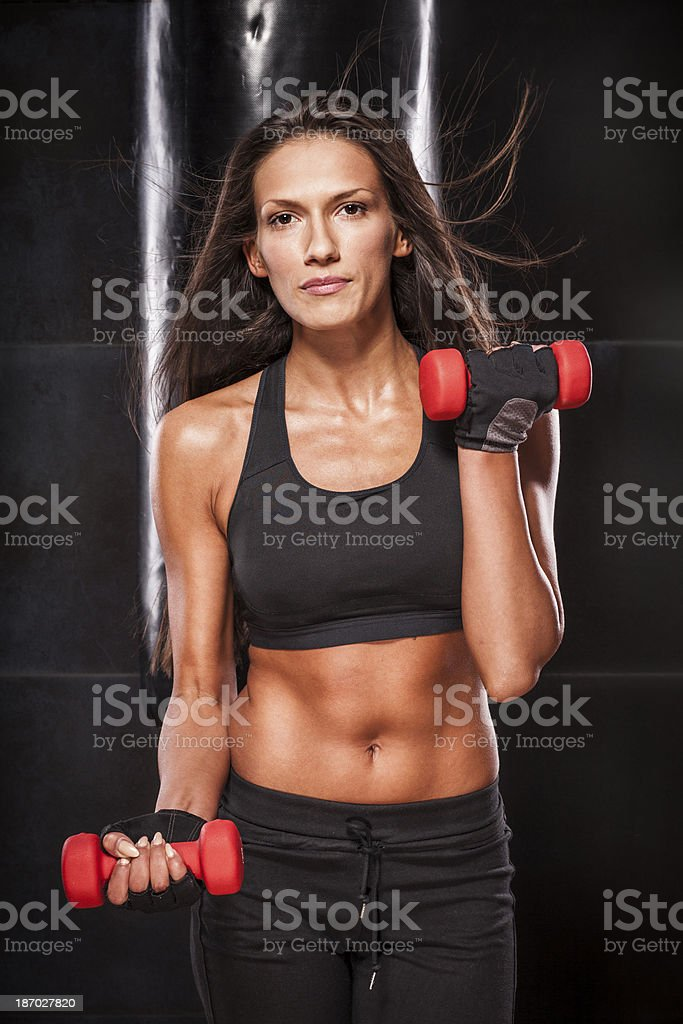 Beautiful young woman exercising royalty-free stock photo