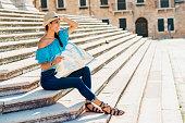 beautiful young woman exploring travel destinations