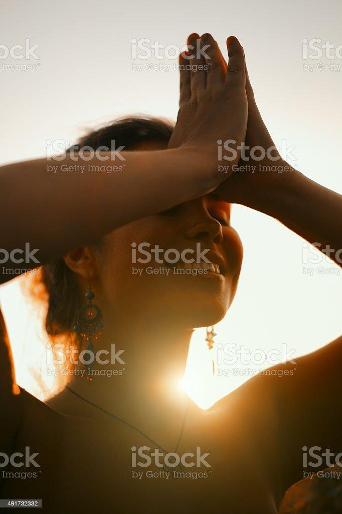Beautiful young woman face at sunset stock photo