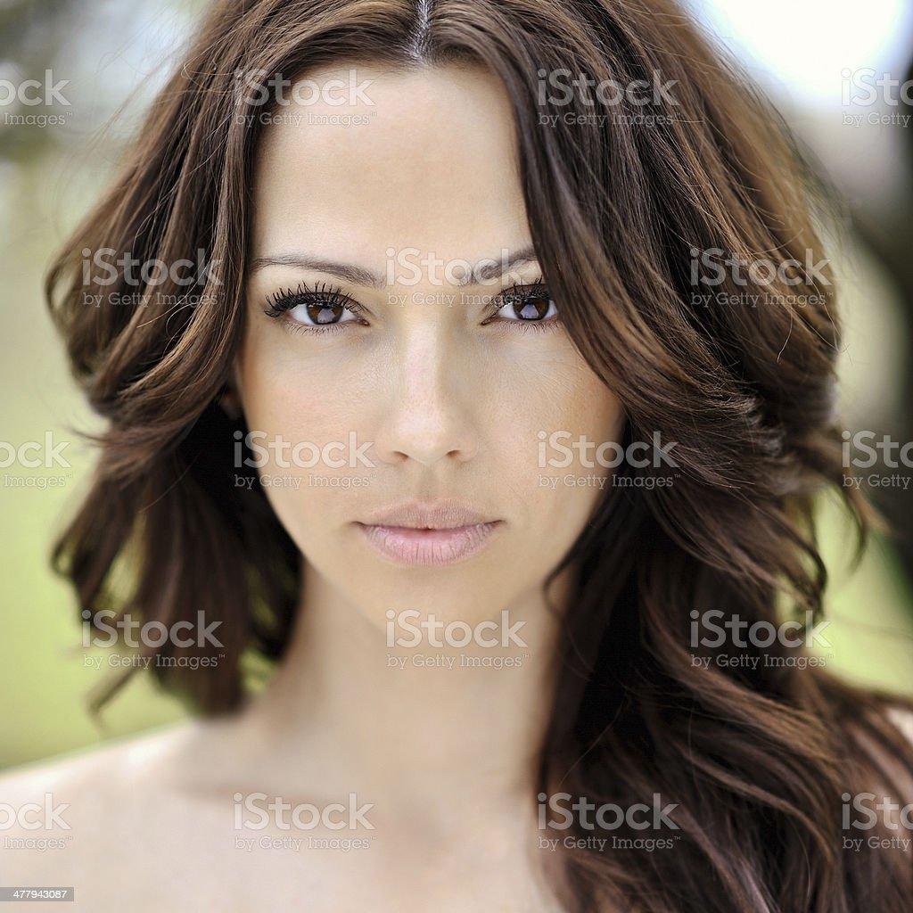 Beautiful young woman face closeup - perfect skin stock photo