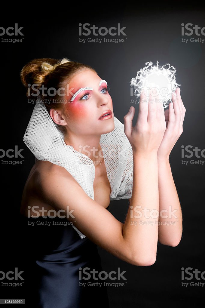 Beautiful Young Woman Fashion Model in Gown, Makeup, Holding Orb royalty-free stock photo