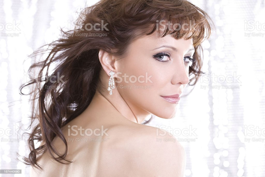 Beautiful Young Woman Fashion Model Over Shoulder in Diamond Earrings royalty-free stock photo