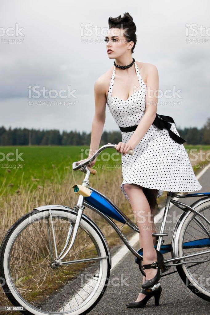 Beautiful Young Woman Fashion Model, Retro Dress and Bike, Country stock photo